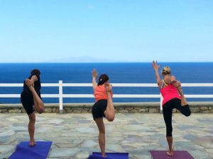 yoga balances in mykonos by the sea with Yoga Escapes