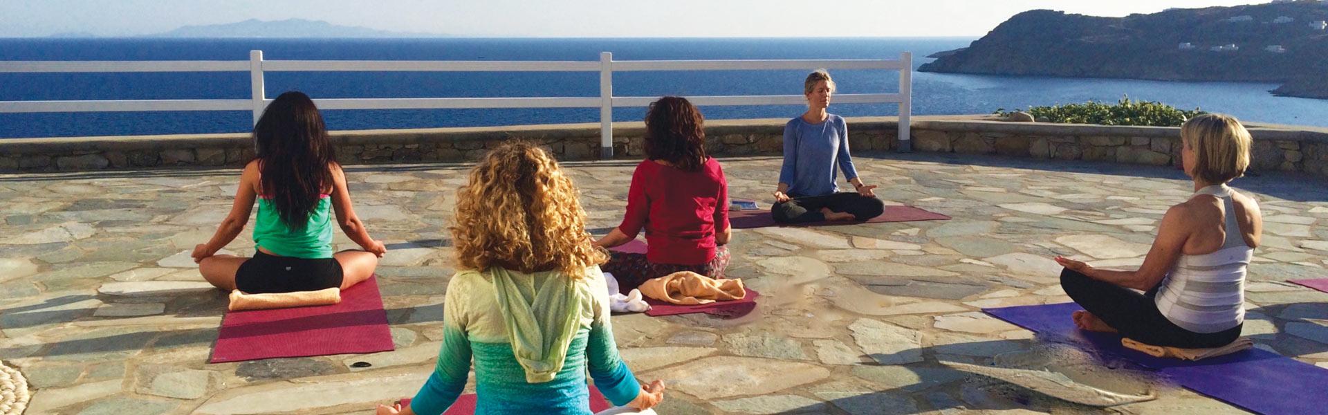 yoga escapes shot overlooking the sea