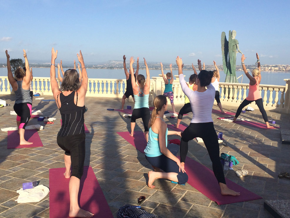 Yoga Escapes team to forward lunges in Italy