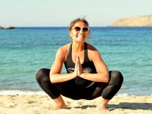 Yoga on Panormos beach in Mykonos Greece with Yoga Escapes