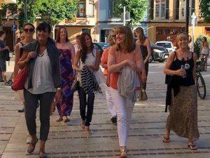 yoga group walking around ciutadella town in menorca spain