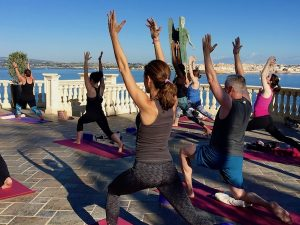 yoga lunges on a luxury yoga retreat in italy with Yoga Escapes