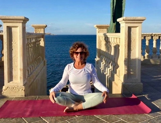 yoga on a seaview terrace in sicily italy at the 5* minareto hotel