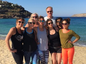 yoga group on panormos beach in mykonos