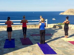 tadasana pose on a yoga retreat in mykonos greece