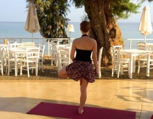 Yoga tree pose at the luxury yoga retreat in Crete.