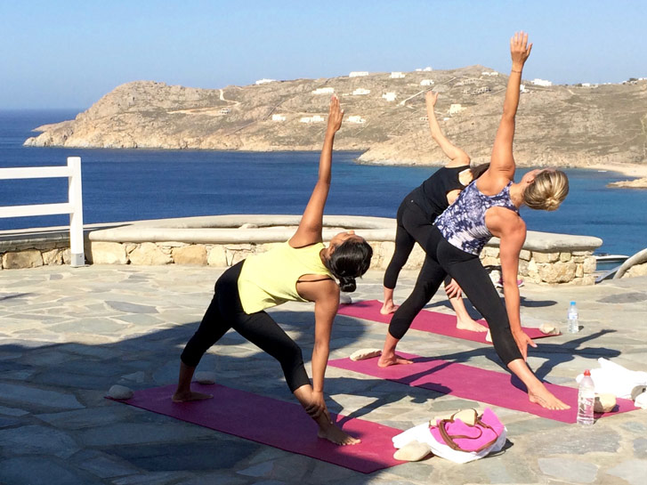 Yoga triangle pose Mykonos Yoga Escapes