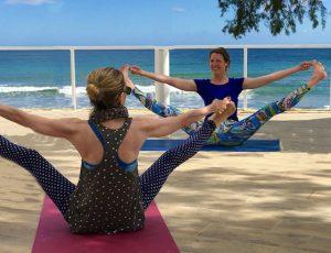 yoga wide legged pose on a luxury yoga retreat in crete greece with yoga escapes