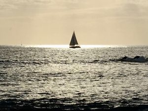 sailing at sunset in tenerife in the canary islands with yoga escapes