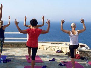 balancing yoga poses on a greece yoga retreat with yoga escapes