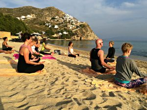 yoga classes on the beach in mykonos with yoga escapes