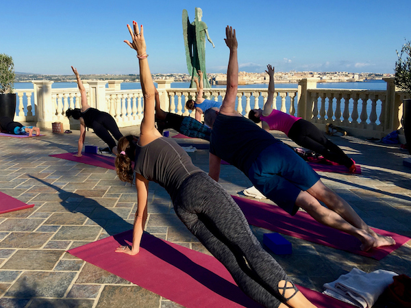 side plank yoga pose on a yoga retreat in italy