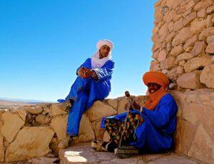 men taking a break in the desert in Morocco