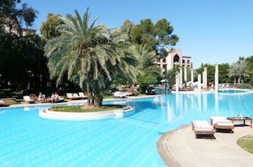 relaxing by the pool at the es saadi palace 5* hotel on a yoga retreat in marrakesh morocco