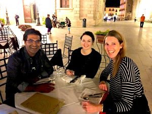 dinner outdoors in the main square in ortigia sicily on a yoga retreat in italy