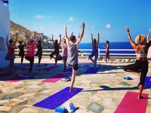 tree pose yoga in mykonos greece with yoga escapes