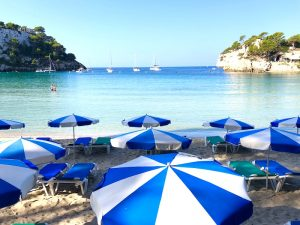 umbrellas cala galdana luxury yoga retreat menorca spain