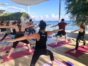 warrior two on a yoga retreat in crete greece with yoga escapes