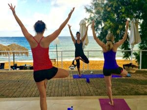 balances on a yoga retreat in crete greece