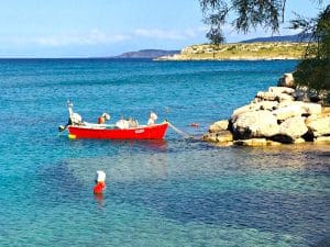 small boat in crete greece with yoga escapes