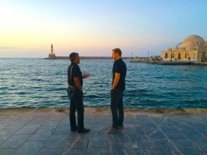 strolling around chania harbor in crete at dusk with yoga escapes