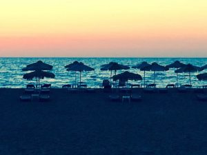 sunset in chania crete with yoga escapes