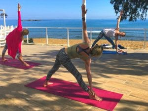 vinyasa flow class on a luxury yoga retreat in crete greece with yoga escapes