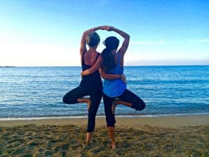 yoga on the beach at dusk in crete greece with yoga escapes